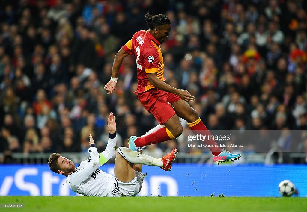 <a gi-track='captionPersonalityLinkClicked' href=/galleries/search?phrase=Didier+Drogba&family=editorial&specificpeople=179398 ng-click='$event.stopPropagation()'>Didier Drogba</a> of Galatasaray is challenged by Sergio Ramos of Real Madrid during the UEFA Champions League Quarter Final first leg match between Real Madrid and Galatasaray at Estadio Santiago Bernabeu on April 3, 2013 in Madrid, Spain.