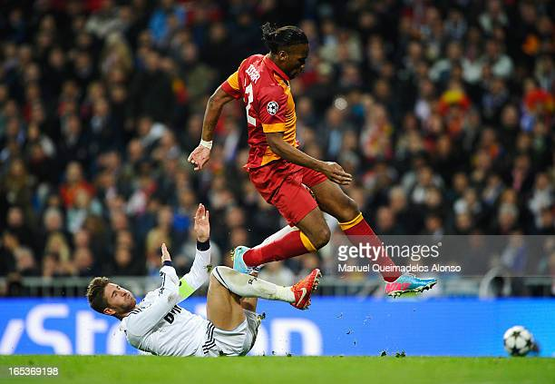 Didier Drogba of Galatasaray is challenged by Sergio Ramos of Real Madrid during the UEFA Champions League Quarter Final first leg match between Real...