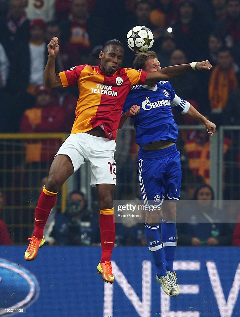 Didier Drogba (L) of Galatasaray jumps for a header with Benedikt Hoewedes of Schalke during the UEFA Champions League Round of 16 first leg match between Galatasaray and FC Schalke 04 at the Turk Telekom Arena on February 20, 2013 in Istanbul, Turkey.
