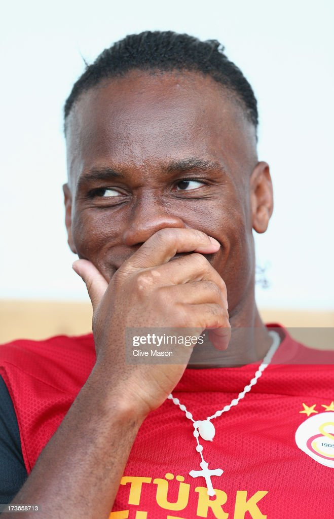 Didier Drogba of Galatasaray looks on from the bench during the pre season friendly match between Notts County and Galatasaray at Meadow Lane on July 16, 2013 in Nottingham, England.