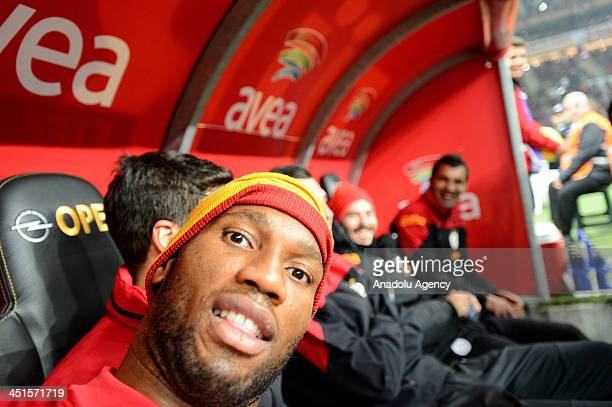Didier Drogba of Galatasaray takes his photo by using Anadolu Agency photojournalist's camera before the Turkish Super League match between...