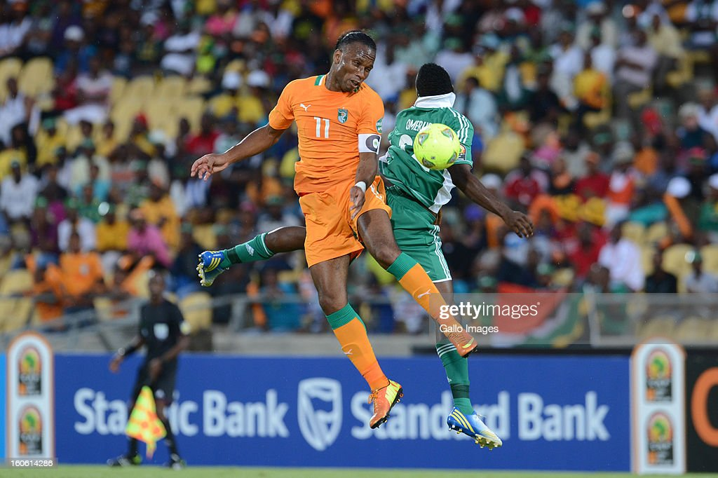 <a gi-track='captionPersonalityLinkClicked' href=/galleries/search?phrase=Didier+Drogba&family=editorial&specificpeople=179398 ng-click='$event.stopPropagation()'>Didier Drogba</a> of Ivory Coast and Kenneth Omeruo of Nigeria during the 2013 Orange African Cup of Nations 3rd Quarter Final match between Ivory Coast and Nigeria at Royal Bafokeng Stadium on February 03, 2013 IN Rustenburg, South Africa.
