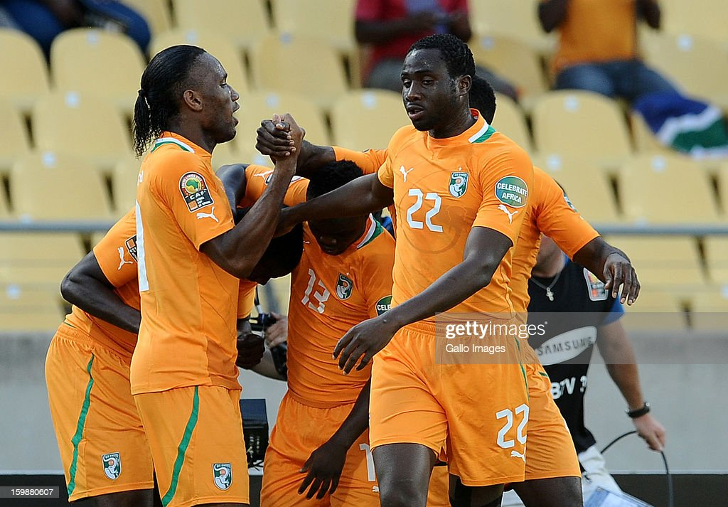 <a gi-track='captionPersonalityLinkClicked' href=/galleries/search?phrase=Didier+Drogba&family=editorial&specificpeople=179398 ng-click='$event.stopPropagation()'>Didier Drogba</a> of Ivory Coast (L) celebrates with team-mates after the team scored a goal during the 2013 Orange African Cup of Nations match between Ivory Coast and Togo at Royal Bafokeng Stadium on January 22, 2013 in Rustenburg, South Africa.