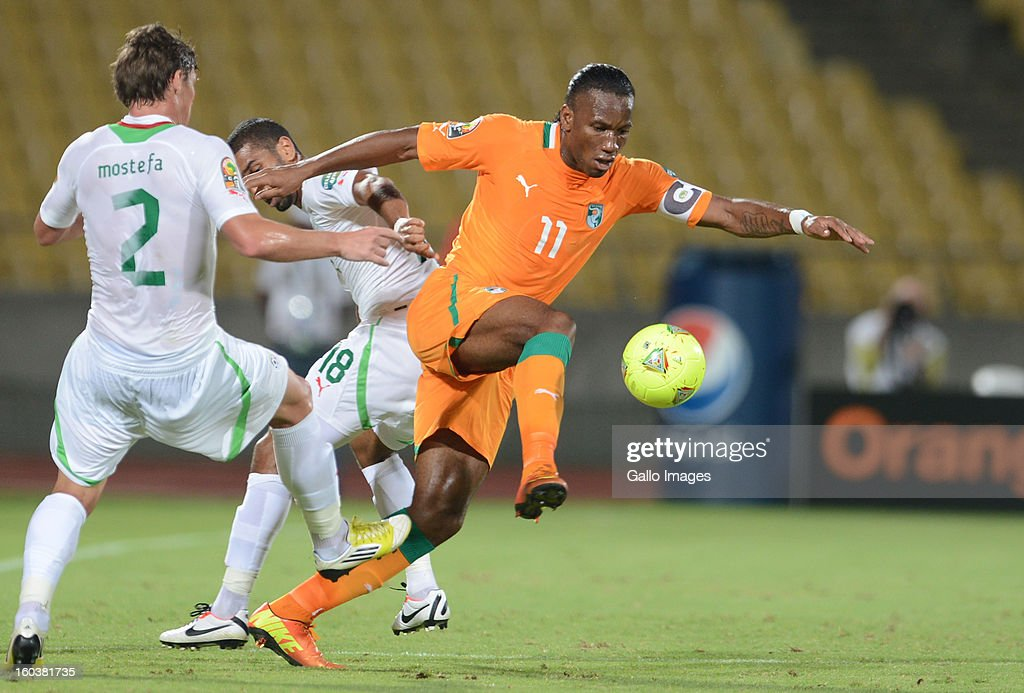 <a gi-track='captionPersonalityLinkClicked' href=/galleries/search?phrase=Didier+Drogba&family=editorial&specificpeople=179398 ng-click='$event.stopPropagation()'>Didier Drogba</a> of Ivory Coast competes with Mehdi Mostefa-Sbaa of Algeria during the 2013 African Cup of Nations match between Algeria and Ivory Coast at Royal Bafokeng Stadium on January 30, 2013 in Rustenburg, South Africa.