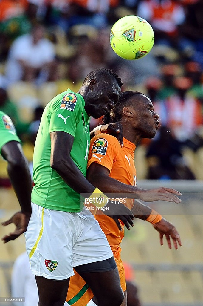 <a gi-track='captionPersonalityLinkClicked' href=/galleries/search?phrase=Didier+Drogba&family=editorial&specificpeople=179398 ng-click='$event.stopPropagation()'>Didier Drogba</a> of Ivory Coast (R) vies with Dare Nibombe of Togo during the 2013 Orange African Cup of Nations match between Ivory Coast and Togo at Royal Bafokeng Stadium on January 22, 2013 in Rustenburg, South Africa.