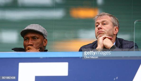 Didier Drogba of Montreal Impact and Chelsea owner Roman Abramovich are seen on the stand during the Barclays Premier League match between Chelsea...
