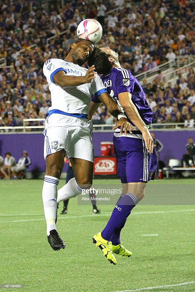 Didier Drogba #11 of Montreal Impact and Luke Boden #14 of Orlando City SC fight for a header during an MLS soccer match between the Montreal Impact and the Orlando City SC at the Orlando Citrus Bowl on October 3, 2015 in Orlando, Florida. Orlando won the match 2-1.