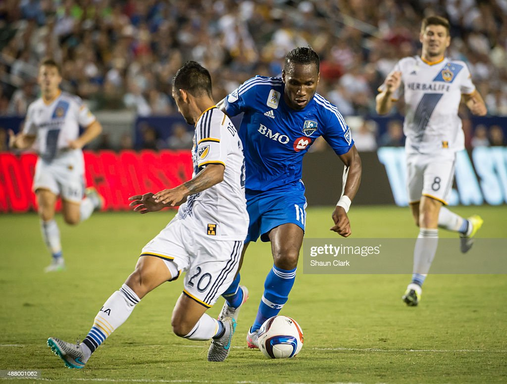 Didier Drogba #11 of Montreal Impact battles A.J. DeLaGarza #20 of Los Angeles Galaxy during Los Angeles Galaxy's MLS match against Montreal Impact at the StubHub Center on September 12, 2015 in Carson, California. The match ended in 0-0 tie