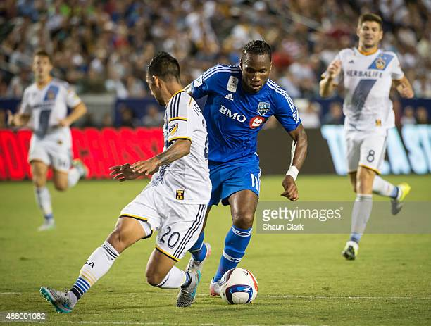 Didier Drogba of Montreal Impact battles AJ DeLaGarza of Los Angeles Galaxy during Los Angeles Galaxy's MLS match against Montreal Impact at the...