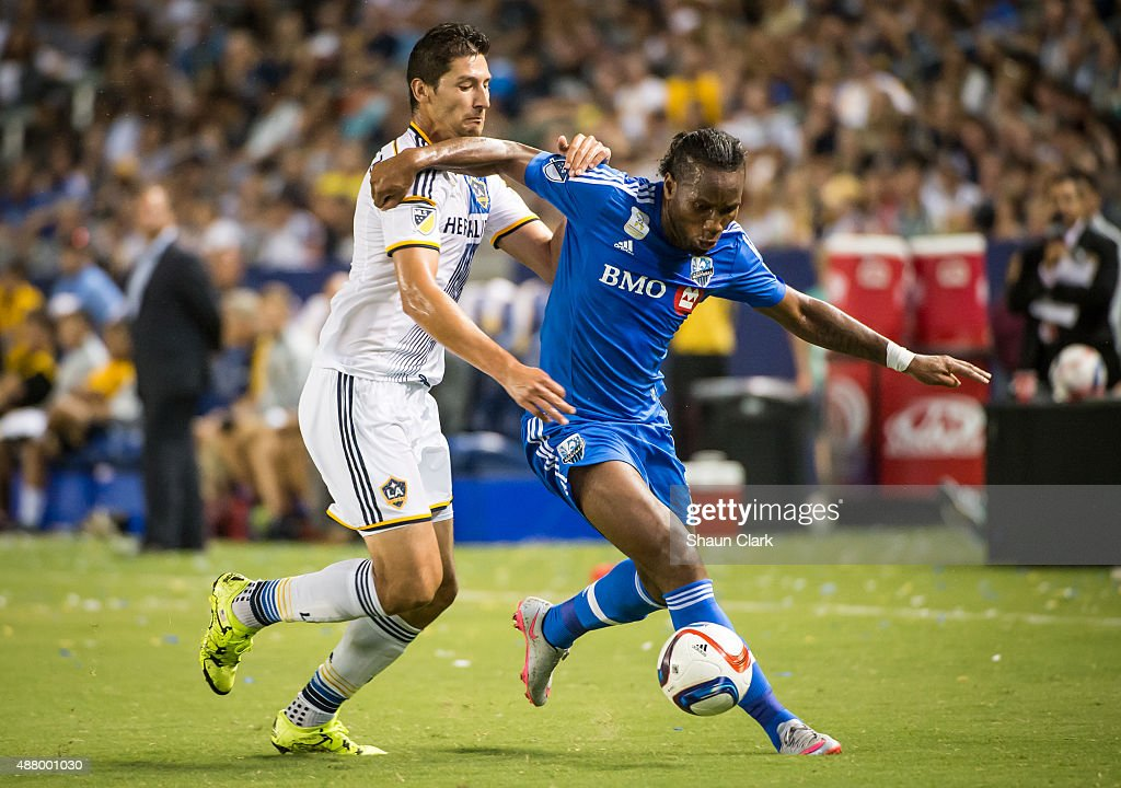 Didier Drogba #11 of Montreal Impact battles Omar Gonzalez #4 of Los Angeles Galaxy during Los Angeles Galaxy's MLS match against Montreal Impact at the StubHub Center on September 12, 2015 in Carson, California. The match ended in 0-0 tie