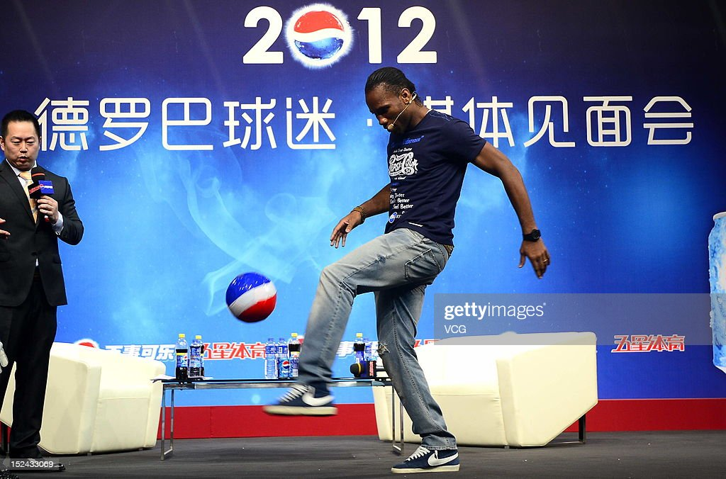 <a gi-track='captionPersonalityLinkClicked' href=/galleries/search?phrase=Didier+Drogba&family=editorial&specificpeople=179398 ng-click='$event.stopPropagation()'>Didier Drogba</a> of Shanghai Shenhua attends a meeting with fans on September 20, 2012 in Shanghai, China.