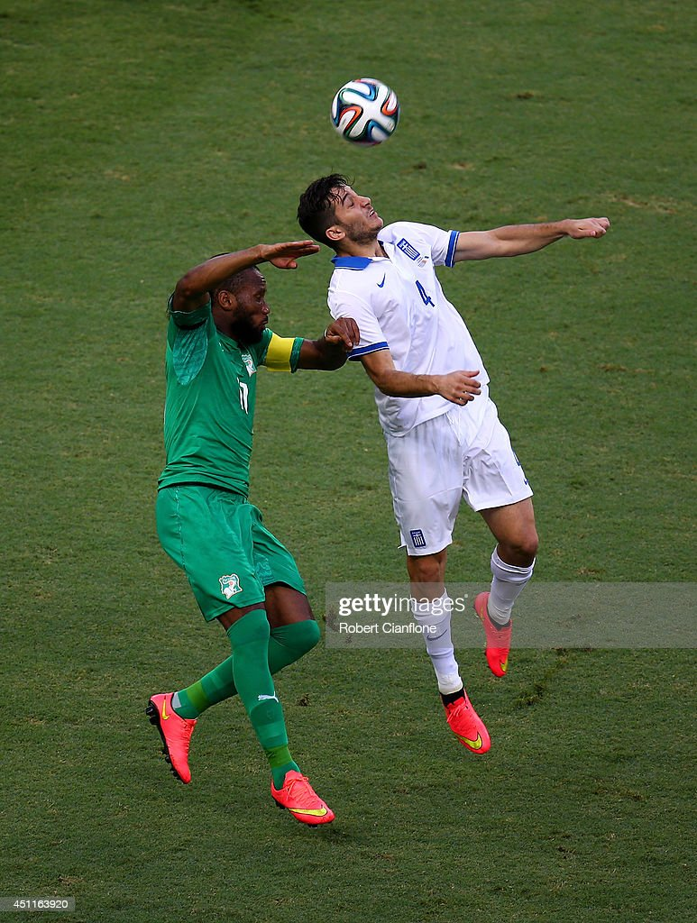 <a gi-track='captionPersonalityLinkClicked' href=/galleries/search?phrase=Didier+Drogba&family=editorial&specificpeople=179398 ng-click='$event.stopPropagation()'>Didier Drogba</a> of the Ivory Coast and Konstantinos Manolas of Greece go up for a header during the 2014 FIFA World Cup Brazil Group C match between Greece and the Ivory Coast at Castelao on June 24, 2014 in Fortaleza, Brazil.