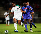 Didier Drogba of the Ivory Coast is challenged by Lilian Thuram of France during the International Friendly match between France and Ivory Coast at...