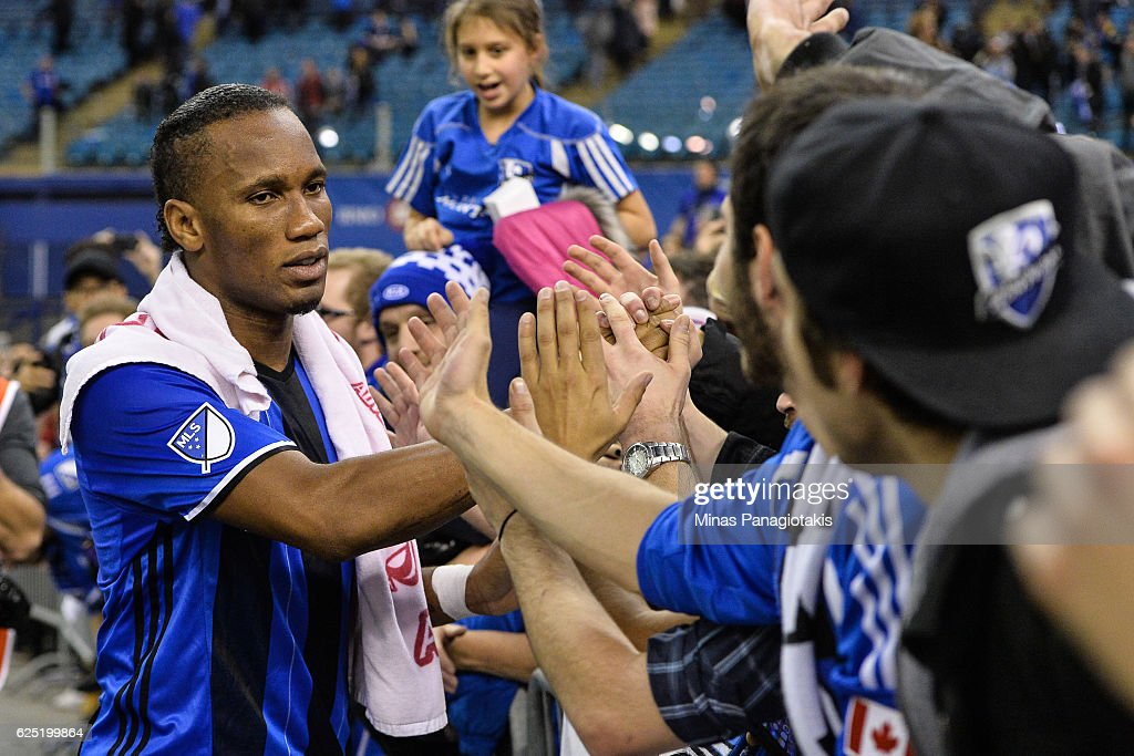 Didier Drogba #11 of the Montreal Impact celebrates with fans during leg one of the MLS Eastern Conference finals against the Toronto FC at Olympic Stadium on November 22, 2016 in Montreal, Quebec, Canada. The Montreal Impact defeated the Toronto FC