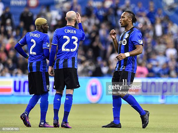Didier Drogba of the Montreal Impact consults with teammates Laurent Ciman and Ambroise Oyongo during leg one of the MLS Eastern Conference finals...