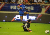 Didier Drogba scores his first goal for Shanghai Shenhua FC in their game against Hangzhou Greentown in Shanghai on August 4 2012 AFP PHOTO/Peter...