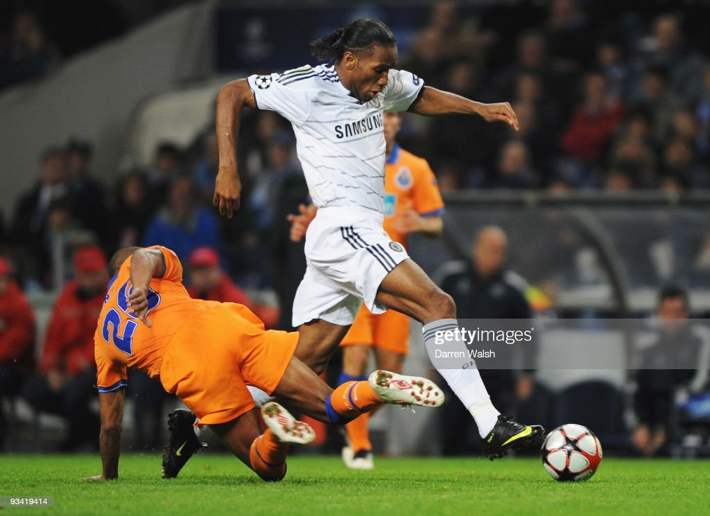 Didier Drogba takes on Fernando Reges of FC Porto during the UEFA Champions League Group D match between FC Porto and Chelsea at the Estadio Do Dragao on November 25, 2009 in Porto, Portugal.