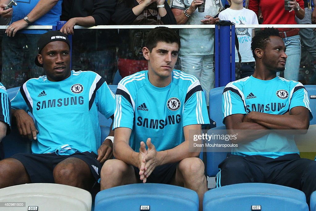 <a gi-track='captionPersonalityLinkClicked' href=/galleries/search?phrase=Didier+Drogba&family=editorial&specificpeople=179398 ng-click='$event.stopPropagation()'>Didier Drogba</a>, <a gi-track='captionPersonalityLinkClicked' href=/galleries/search?phrase=Thibaut+Courtois&family=editorial&specificpeople=7126410 ng-click='$event.stopPropagation()'>Thibaut Courtois</a> and John Obi Mikel of Chelsea watch from the stands prior to the pre season friendly match between Vitesse Arnhem and Chelsea at the Gelredome Stadium on July 30, 2014 in Arnhem, Netherlands.