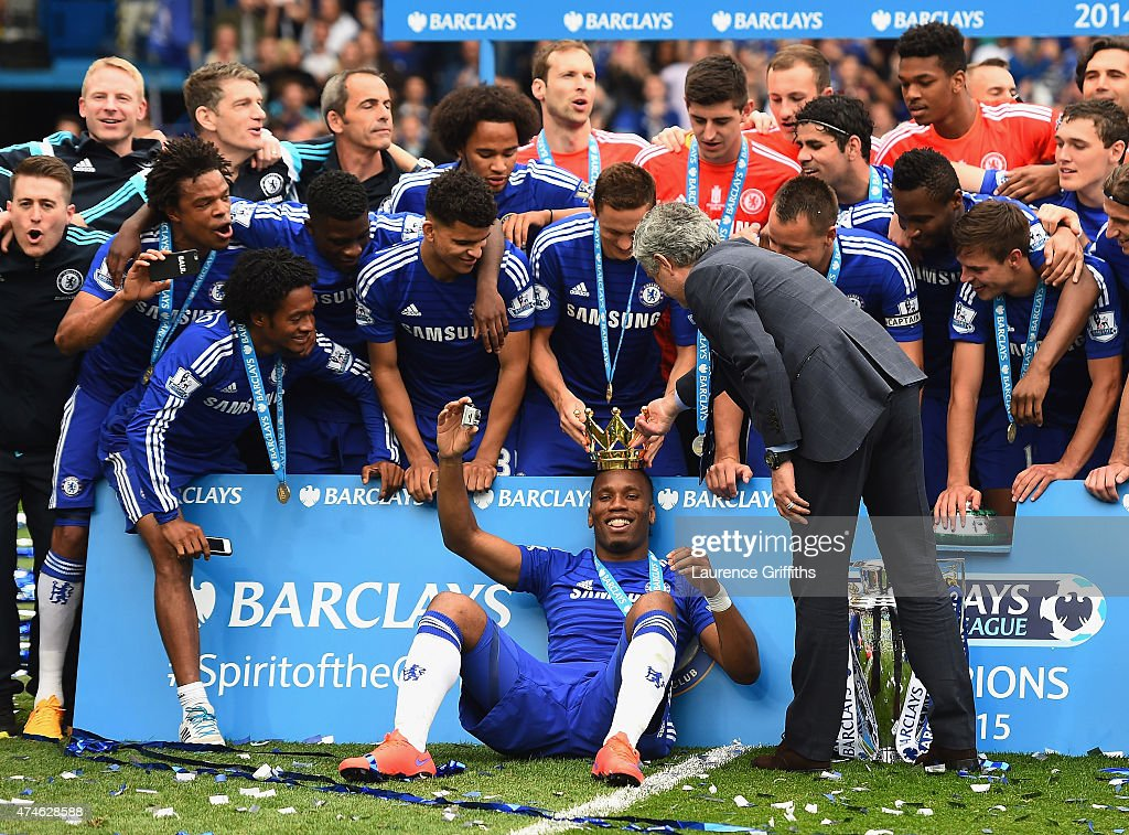 Didier Drogba wears a crown during their Premier League title celebration after the Barclays Premier League match between Chelsea and Sunderland at Stamford Bridge on May 24, 2015 in London, England.
