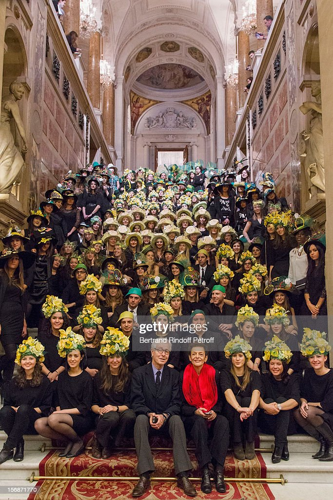 Didier Grumbach (C), President of the Federation Francaise de la Couture, du Pret-a-Porter, des Couturiers et des Createurs de Mode (French Federation of Couture, Ready-to-Wear and Fashion Designers), and Lyne Cohen-Solal, 4th right, deputy mayor in charge of Trade, Crafts, Self-employed and Arts professions, pose with employees of the numerous Paris-based fashion houses at the Paris City Hall during the Sainte-Catherine Celebration on November 23, 2012 in Paris, France.
