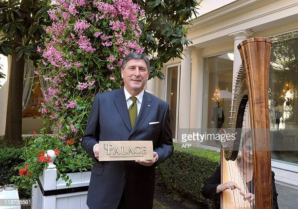 Didier Le Calvez director of the Paris fivestar hotel Bristol shows on May 5 2011 their new plaque reading 'Palace' the French highest rating for...