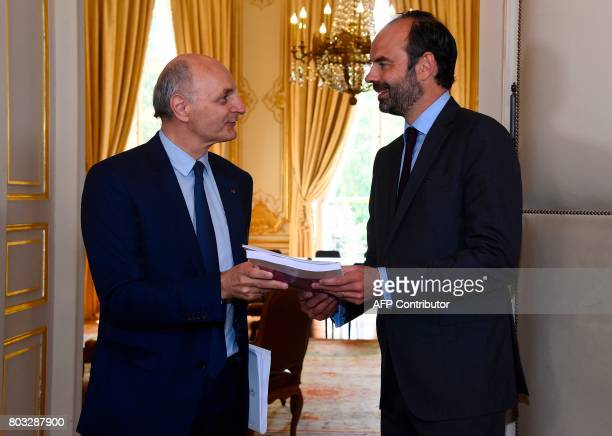 Didier Migaud president of the Court of Auditors handes over a audit report on public finances to French Prime Minister Edouard Philippe at the Hotel...