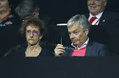Didier Reynders Belgian Deputy Prime Minister and Minister of Foreign Affairs and his wife Bernadette Prignon attend the doubles match during day two...