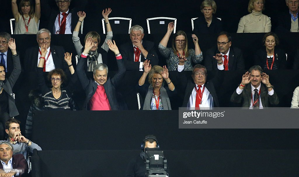 <a gi-track='captionPersonalityLinkClicked' href=/galleries/search?phrase=Didier+Reynders&family=editorial&specificpeople=548982 ng-click='$event.stopPropagation()'>Didier Reynders</a>, Belgian Deputy Prime Minister and Minister of Foreign Affairs (in pink), his wife Bernadette Prignon (left), President of Royal Belgian Tennis Federation Luc Vandaele, President of ITF David Haggerty attend the doubles match during day two of the Davis Cup Final 2015 between Belgium and Great Britain at Flanders Expo on November 28, 2015 in Ghent, Belgium.