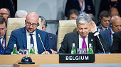 Didier Reynders Chalres Michel during the meeting of heads of state of the North Atlantic Council taking place during a NATO summit on July 8 2016 in...