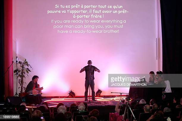 Didier Tanguy from Gabon takes part on June 4 2013 in Paris in the first round of the World Cup of poetry slam held until June 9 AFP PHOTO / JACQUES...