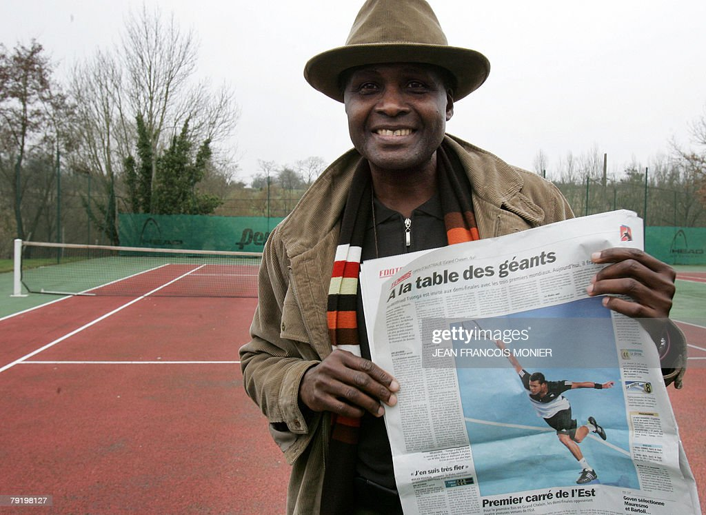 Didier Tsonga, father of French tennisman Jo-Wilfried Tsonga, poses 24 January 2008 in Coulaines, western France, after his son defeated Spanish tennis player Rafael Nadal today to reach the final of the Australian Open. The 22-year-old, nicknamed Muhammad Ali for his likeness to the boxing legend, has now won four of his last five matches against top 15 players.