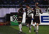 Didier Ya Konan of Hannover 96 celebrates with his team mates after scoring his team's second goal during the Bundesliga match between Hannover 96...