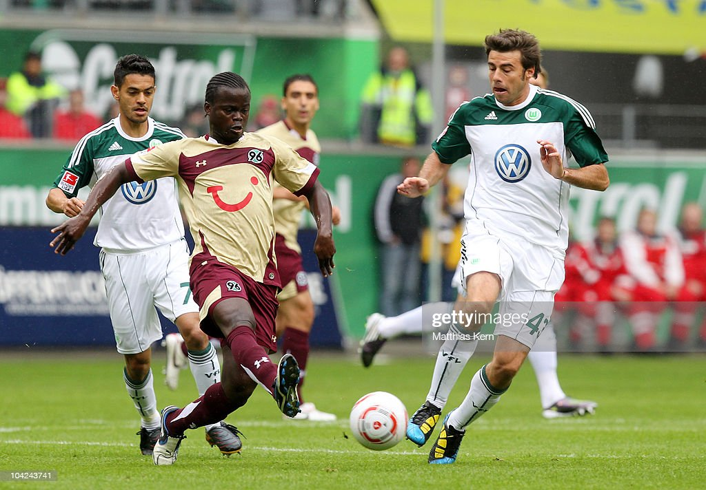 Didier Ya Konan (L) of Hannover battles for the ball with <a gi-track='captionPersonalityLinkClicked' href=/galleries/search?phrase=Andrea+Barzagli&family=editorial&specificpeople=465353 ng-click='$event.stopPropagation()'>Andrea Barzagli</a> (R) of Wolfsburg during the Bundesliga match between VFL Wolfsburg and Hannover 96 at Volkswagen Arena on September 18, 2010 in Wolfsburg, Germany.