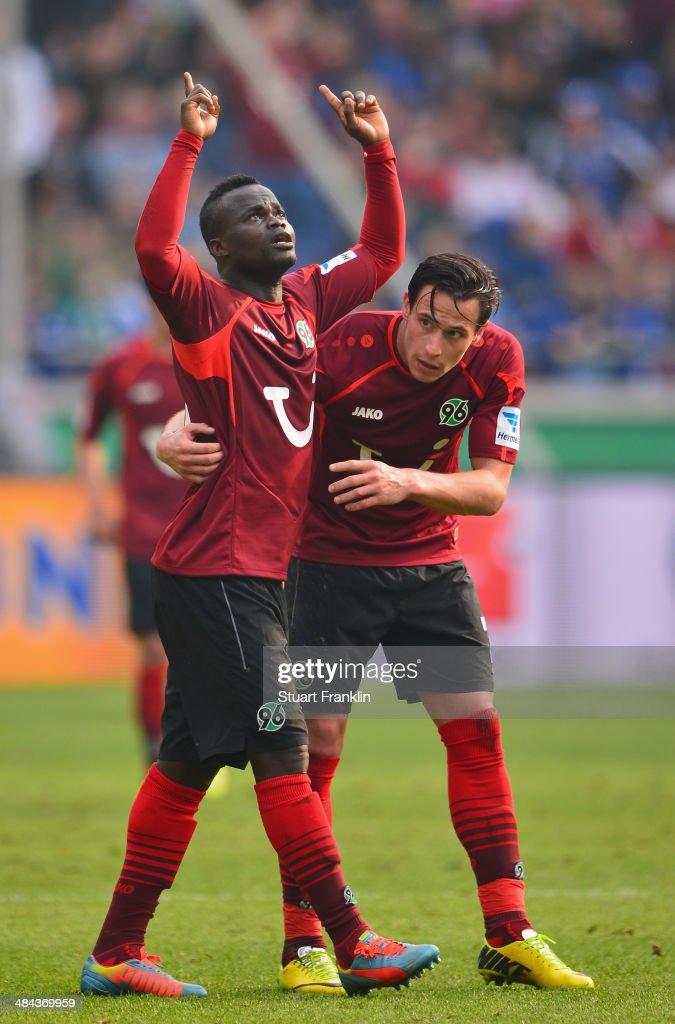 Didier Ya Konan of Hannover celebrates scoring the winning goal with Edgar Prib during the Bundesliga match between Hannover 96 and Hamburger SV at HDI-Arena on April 12, 2014 in Hanover, Germany.
