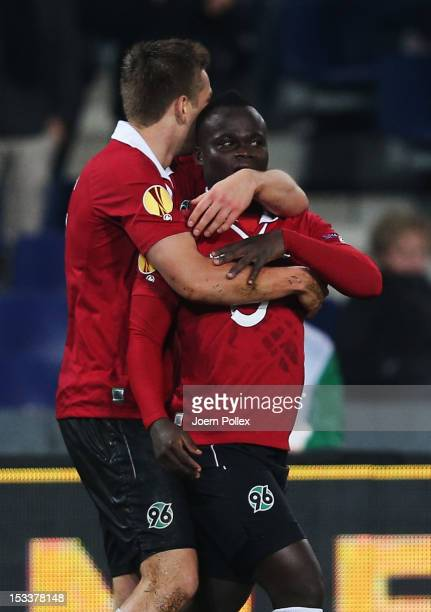 Didier Ya Konan of Hannover celebrates with his team mate Artur Sobiech after scoring his team's second goal during the UEFA Europa League Group L...