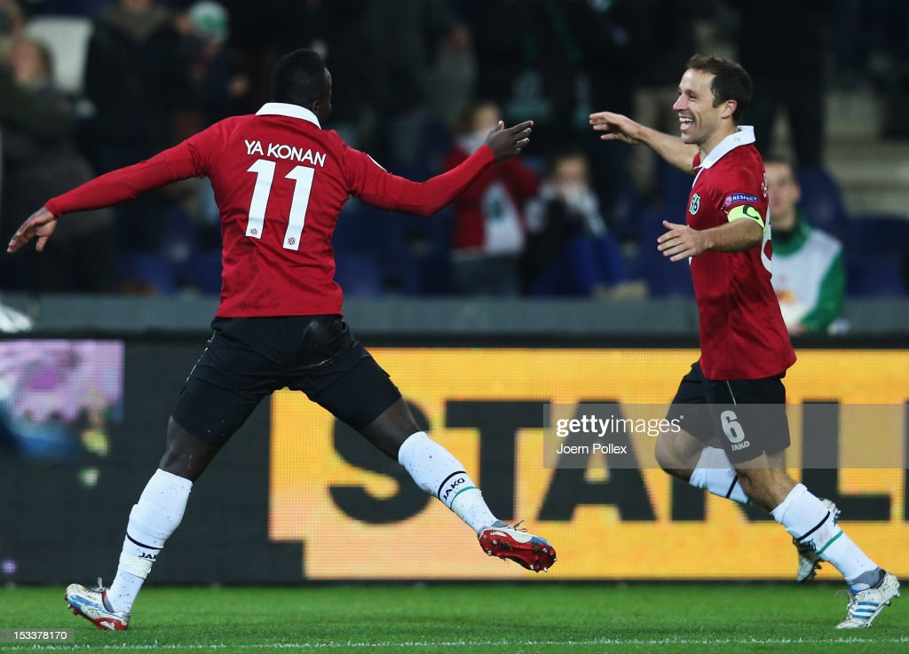 Didier Ya Konan (L) of Hannover celebrates with his team mate Steven Cherundolo after scoring his team's second goal during the UEFA Europa League Group L match between Hannover 96 and Levante UD at AWD Arena on October 4, 2012 in Hannover, Germany.