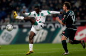 Didier Ya Konan of Hannover in action with Thorben Marx of Moenchengladbach during the Bundesliga match between Borussia Moenchengladbach and...