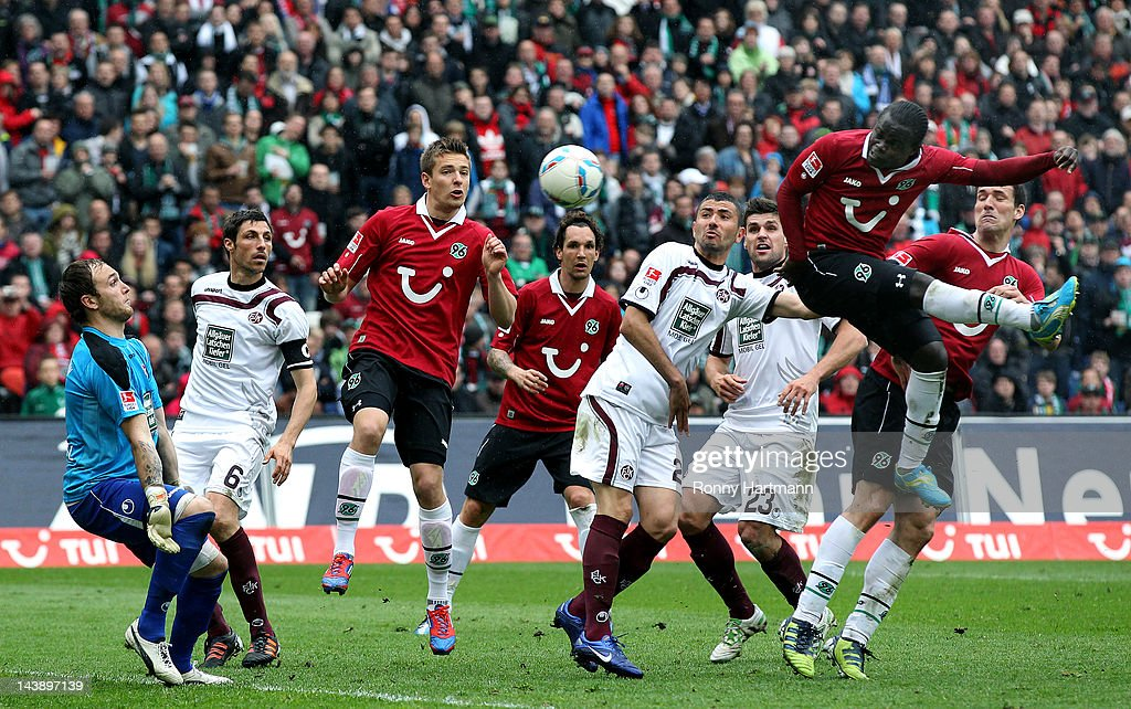 Didier Ya Konan (R) of Hannover scores his team's second goal during the Bundesliga match between Hannover 96 and 1. FC Kaiserslautern at AWD Arena on May 05, 2012 in Hanover, Germany.