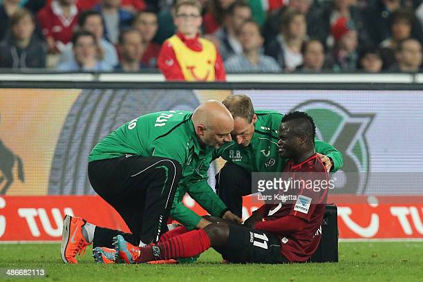 Didier Ya Konan of Hanover lies down with an injury during the Bundesliga match between Hannover 96 and VfB Stuttgart at HDIArena on April 25 2014 in...