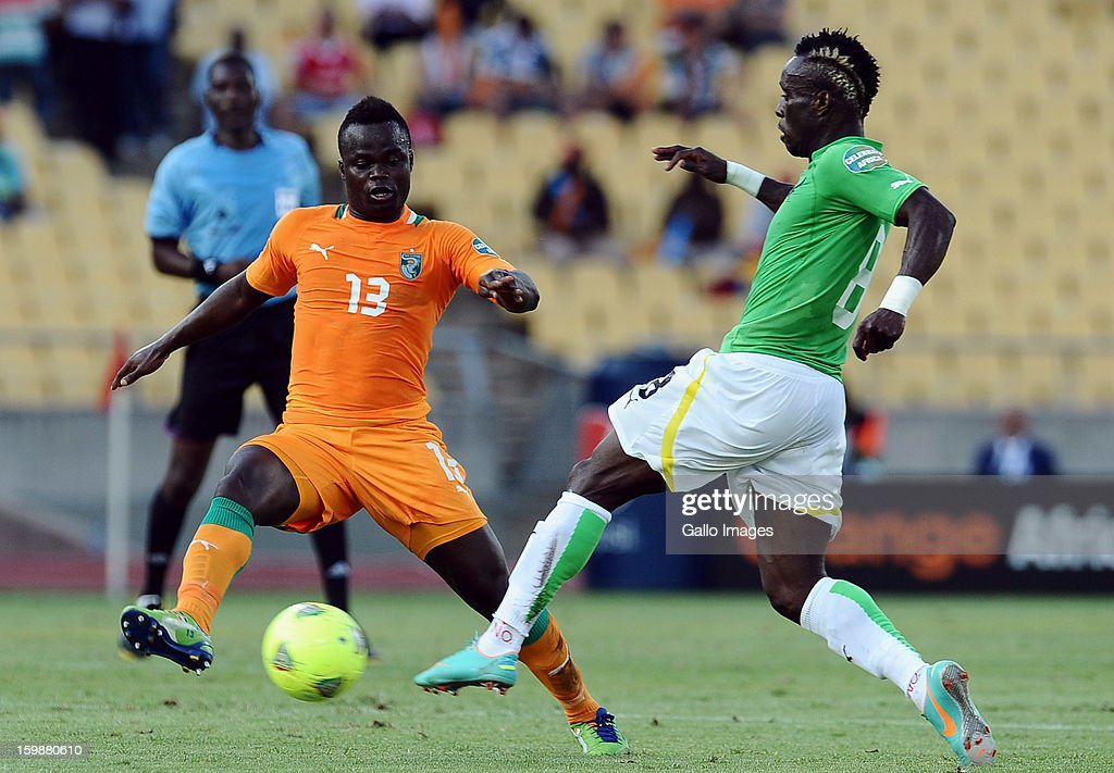 Didier Ya Konan of Ivory Coast vies with Komlan Amewou of Togo during the 2013 Orange African Cup of Nations match between Ivory Coast and Togo at Royal Bafokeng Stadium on January 22, 2013 in Rustenburg, South Africa.