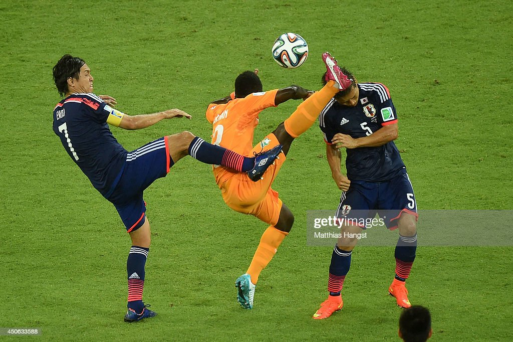 Didier Ya Konan of the Ivory Coast competes for the ball with Yasuhito Endo (L) and Yuto Nagatomo of Japan during the 2014 FIFA World Cup Brazil Group C match between the Ivory Coast and Japan at Arena Pernambuco on June 14, 2014 in Recife, Brazil.