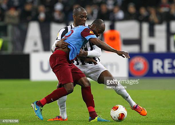 Didier Zokora of AS Trabzonspor competes for the ball with Angelo Ogbonna of Juventus FC during the UEFA Europa League Round of 32 match between...