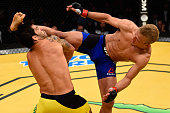 TJ Didllashaw kicks Raphael Assuncao of Brazil in their bantamweight bout during the UFC 200 event on July 9 2016 at TMobile Arena in Las Vegas Nevada