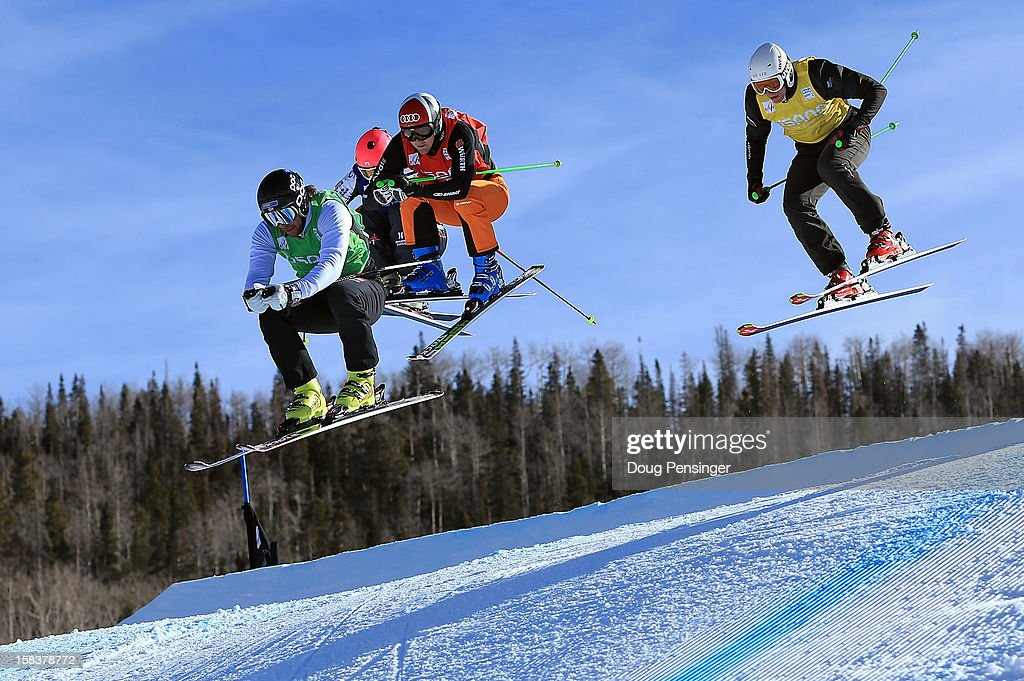 Didrik Bastian Juell of Norway, Arnold Beaucamps of France, Simon Stickl of Germany and Roman Ilin of Russia compete in the eighth finals in the Audi FIS Ski Cross World Cup on December 12, 2012 in Telluride, Colorado.
