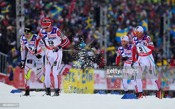 Didrik Toenseth of Norway competes with Alex Harvey of Canada and Niklas Dyrhaug of Norway during the Men's 50km Mass Start CrossCountry during the...