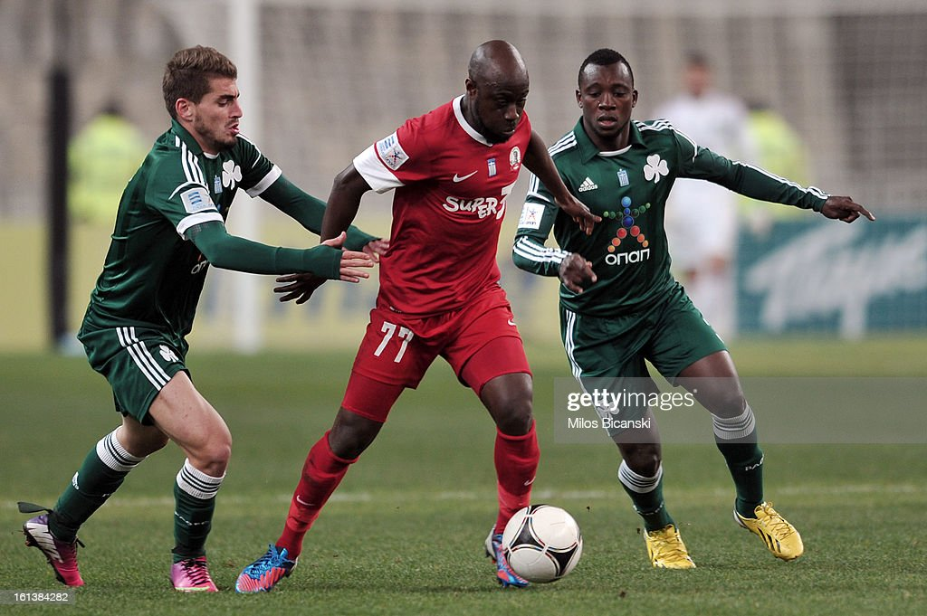 Die Serge (C) of Skoda Xanthi competes for the ball with Charis Mavrias (L) and Ibrahim Sissoko of Panathinaikos FC during the Superleague match between Panathinaikos FC and Skoda Xanthi at OAKA Stadion on February 10, 2013 in Athens,Greece.