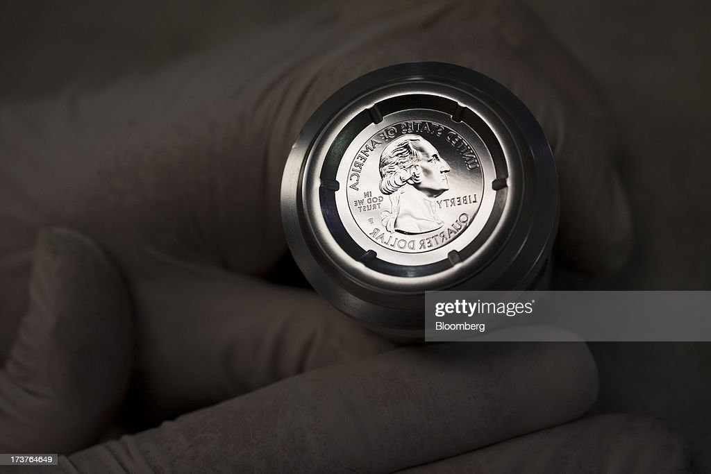 A die to be used for pressing U.S. quarter dollars is displayed for a photograph at the U.S. Mint in Philadelphia, Pennsylvania, U.S., on Wednesday, July 17, 2013. Some sources of declining inflation 'are likely to be transitory' and expectations for future price increases 'have generally remained stable,' Ben S. Bernanke, chairman of the U.S. Federal Reserve said in prepared remarks. Photographer: Scott Eells/Bloomberg via Getty Images