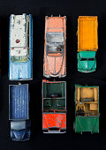 Die-cast zinc alloy miniature vehicles directly above with well worn patina on flea market