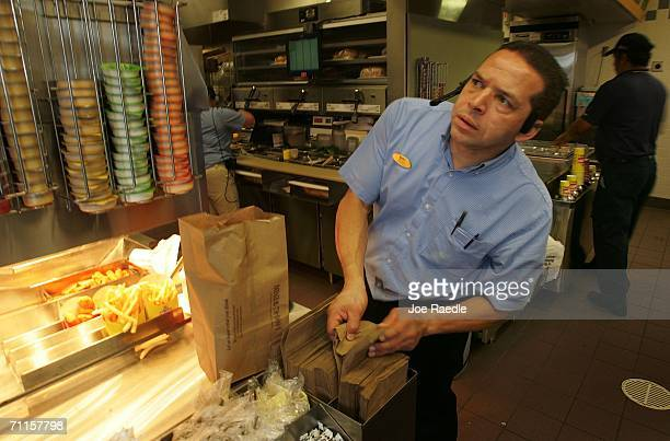 Diego Agudelo prepares to package an order from the drivethrough window June 8 2006 in Miami Florida In a move that significantly reduces trans fatty...