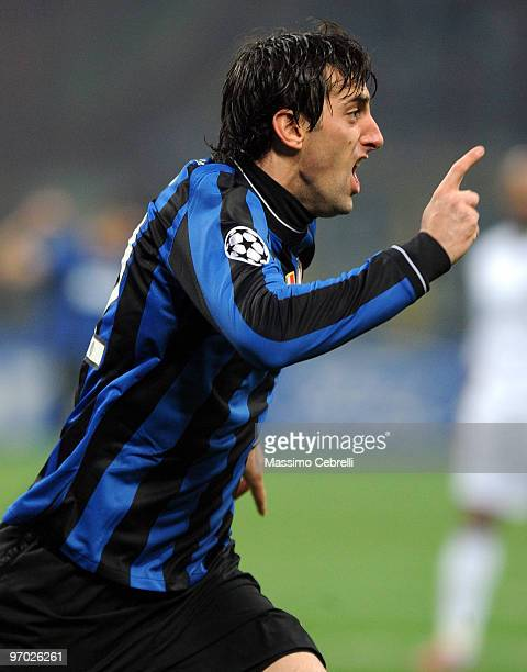Diego Alberto Milito of FC Inter Milan celebrates scoring his team's opening goal during the UEFA Champions League round of 16 first leg match...